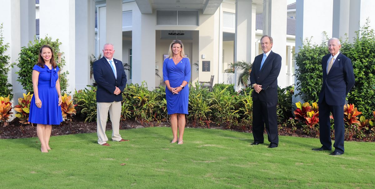 Five Village Council members standing in front of Country Club