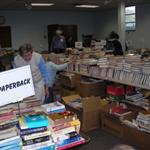 This is an image of a pile of paperback books at the 2009 Book Sale for Friends