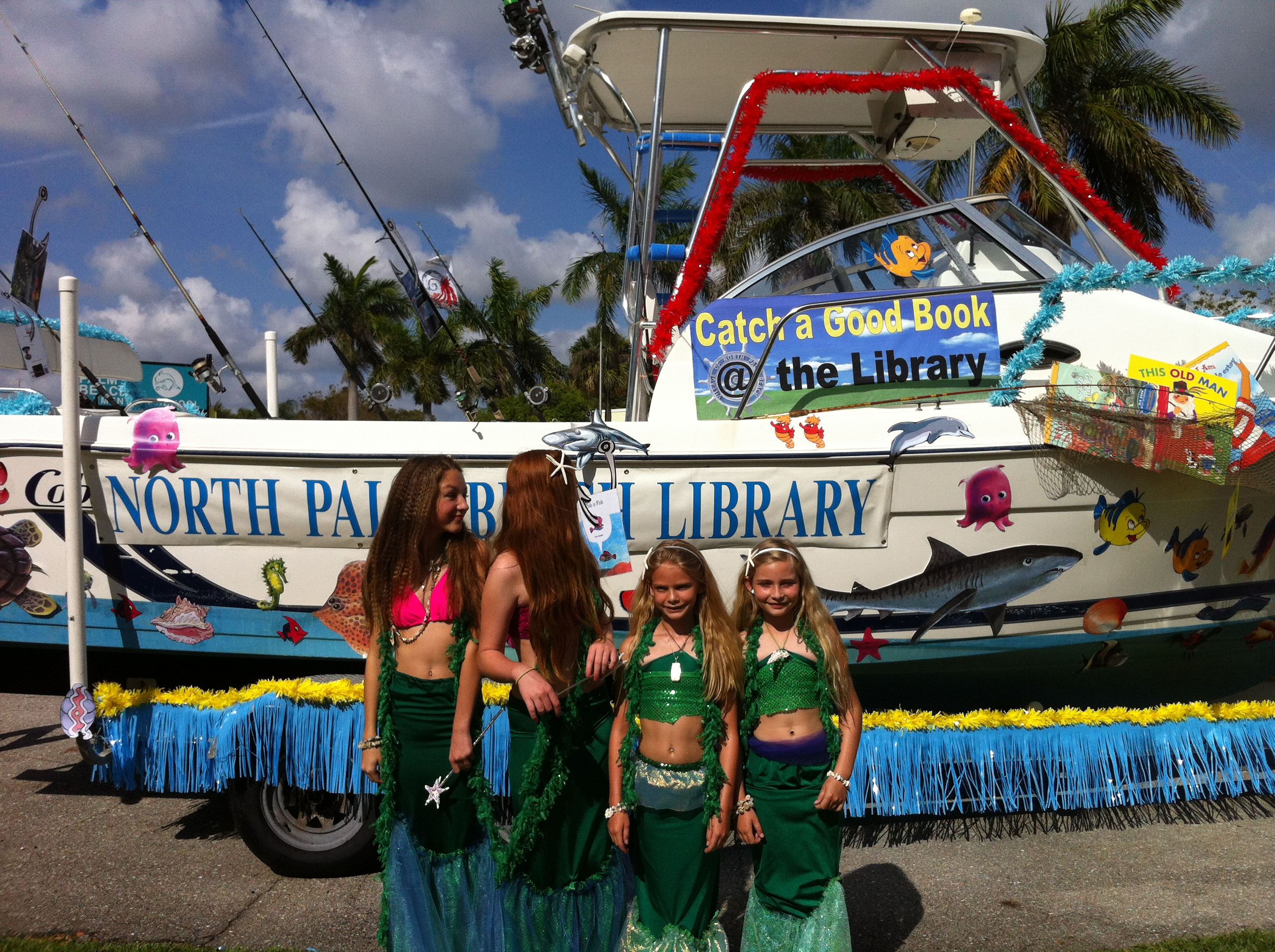 The sea ladies stand in front of the float