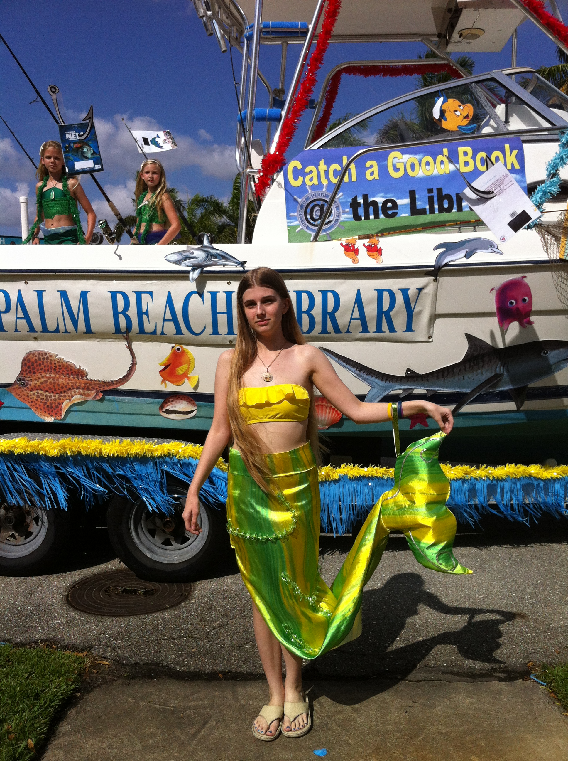 Mermaid stands in front of the float