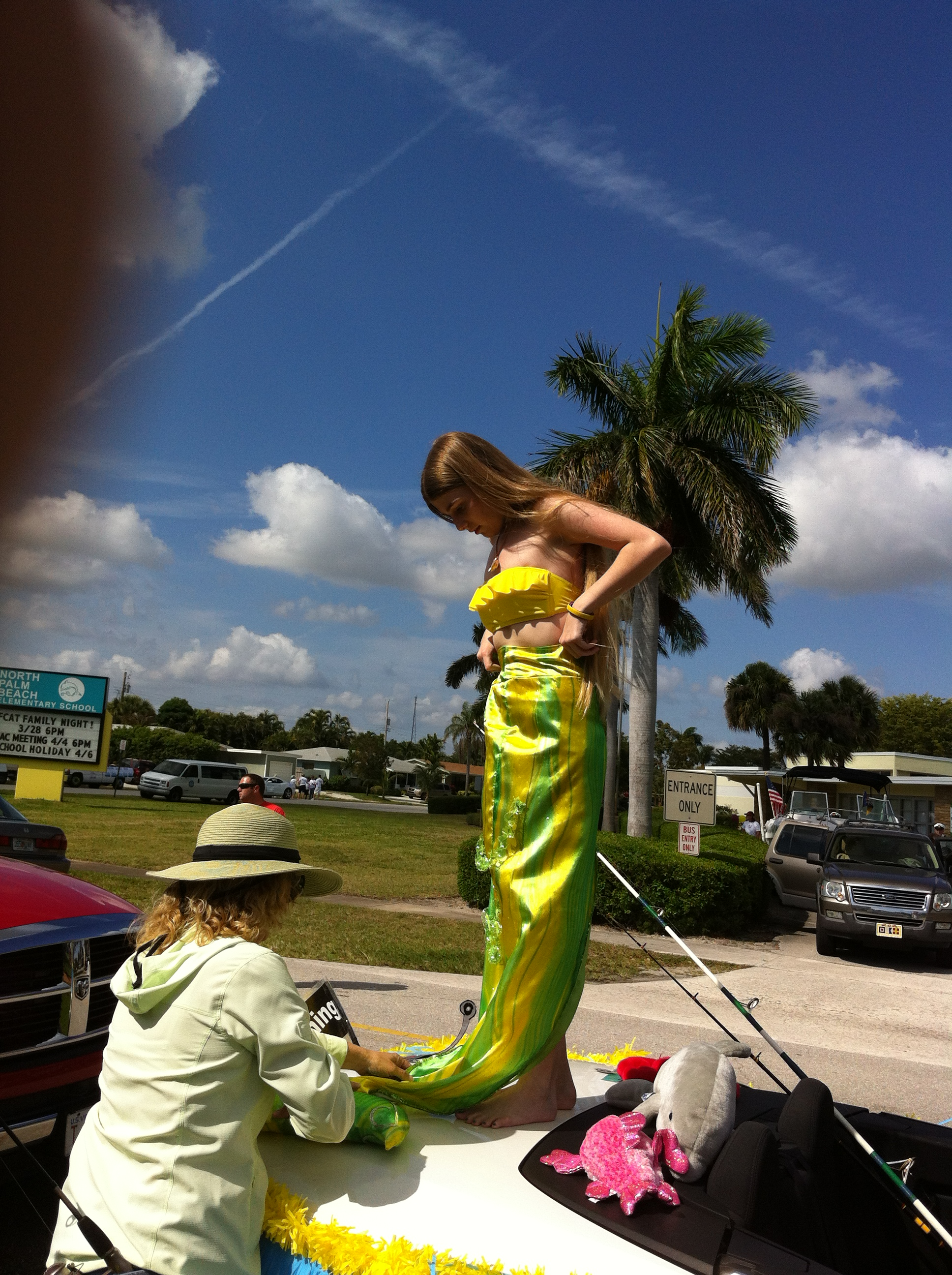 Prepping the mermaid before starting the parade